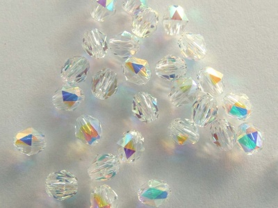 Swarovsk Triangular Facets 5025Clear Crystal Ab 4mm Oval Beads x 4